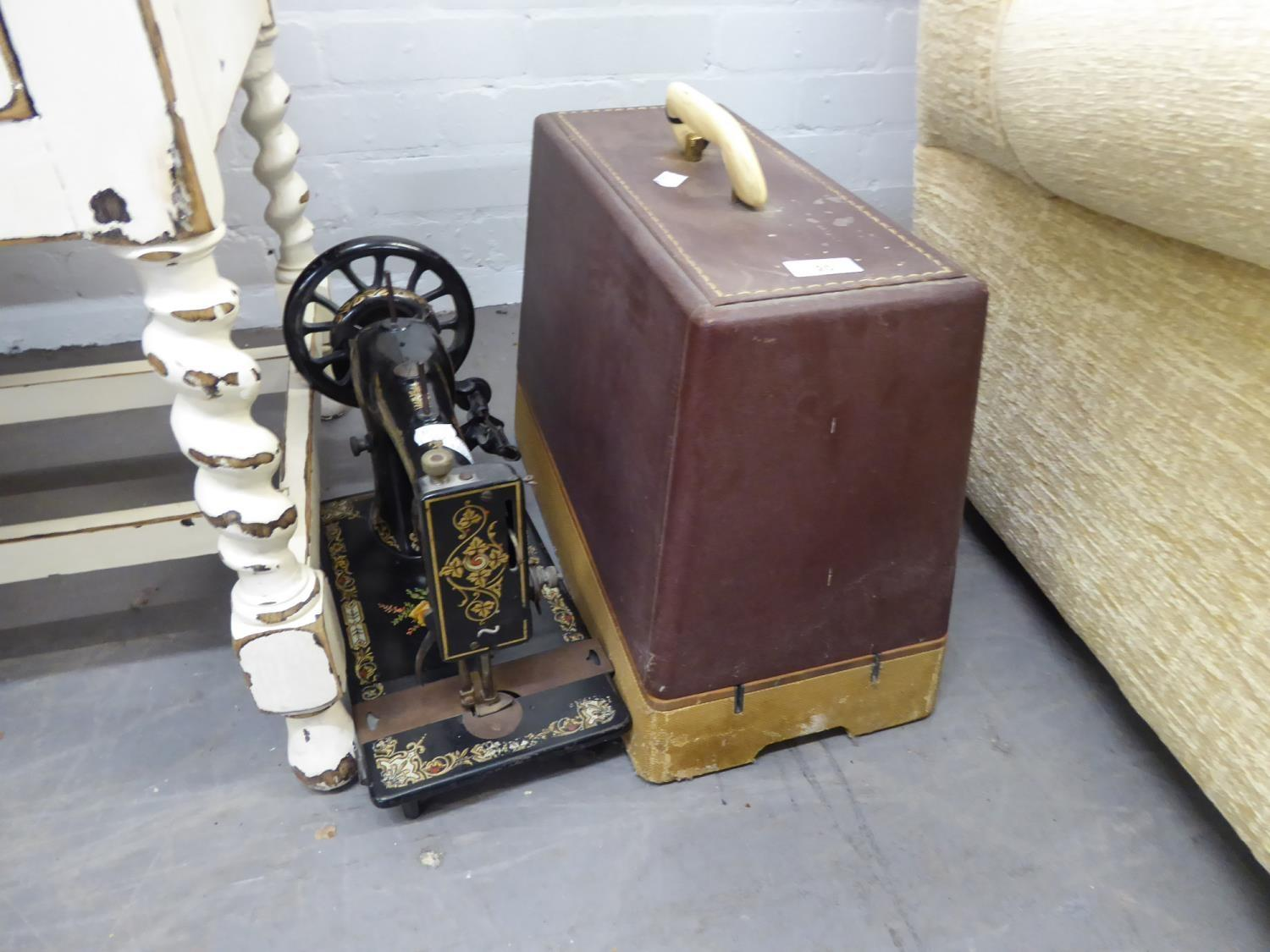 Lot 20 - A JONES SEWING MACHINE WITH DECORATIVE FLORAL DESIGN AND A SINGER 185K SEWING MACHINE IN CARRYING