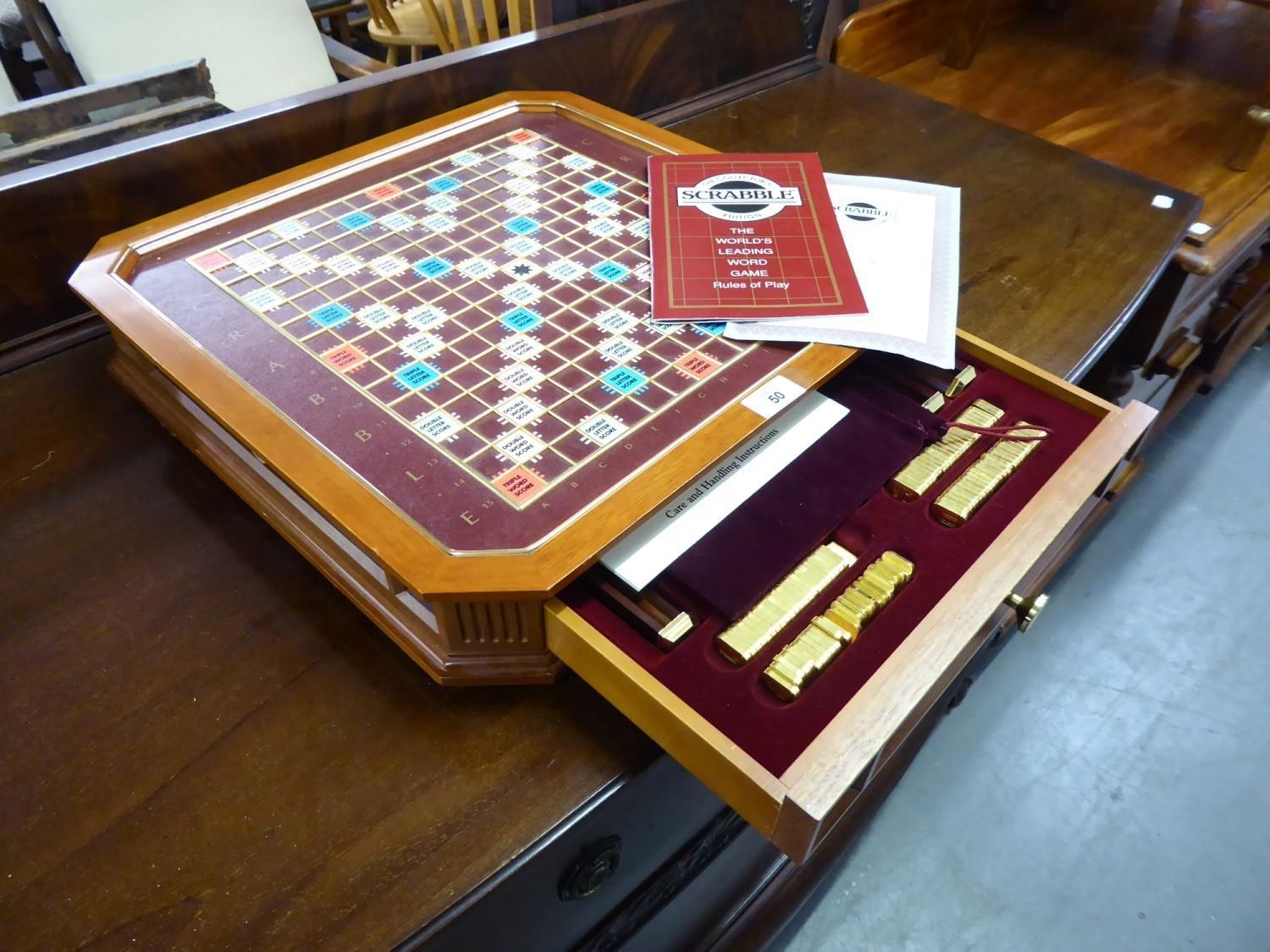 Lot 50 - A DELUXE SCRABBLE COLLECTORS EDITION BOARD GAME, COMPLETE WITH 22CT GOLD PLATED LETTER TILES AND