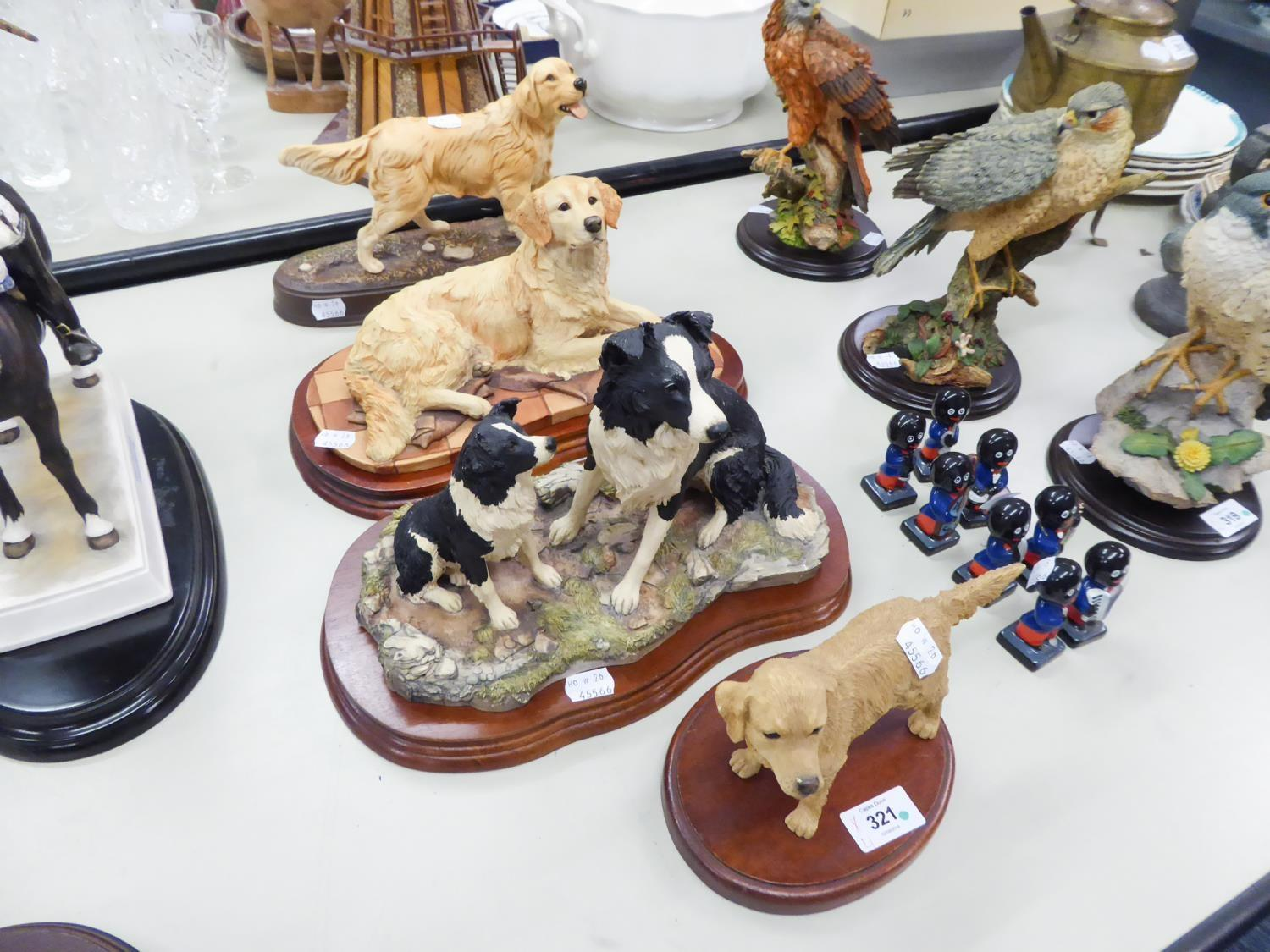 Lot 321 - A MODEL BESWICK FIGURE OF A GOLDEN RETRIEVER ON A PLINTH AND TWO BORDER FINE ARTS OF DOGS ON