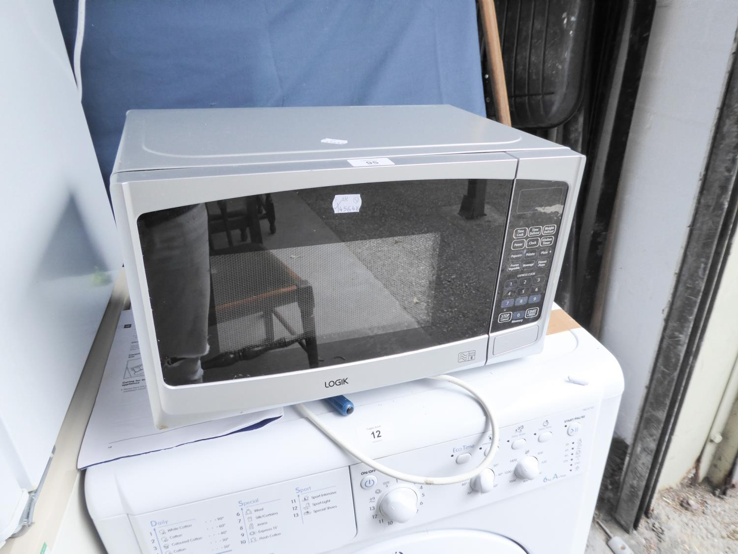 Lot 95 - A LOGIK MICROWAVE OVEN IN SILVER CASE