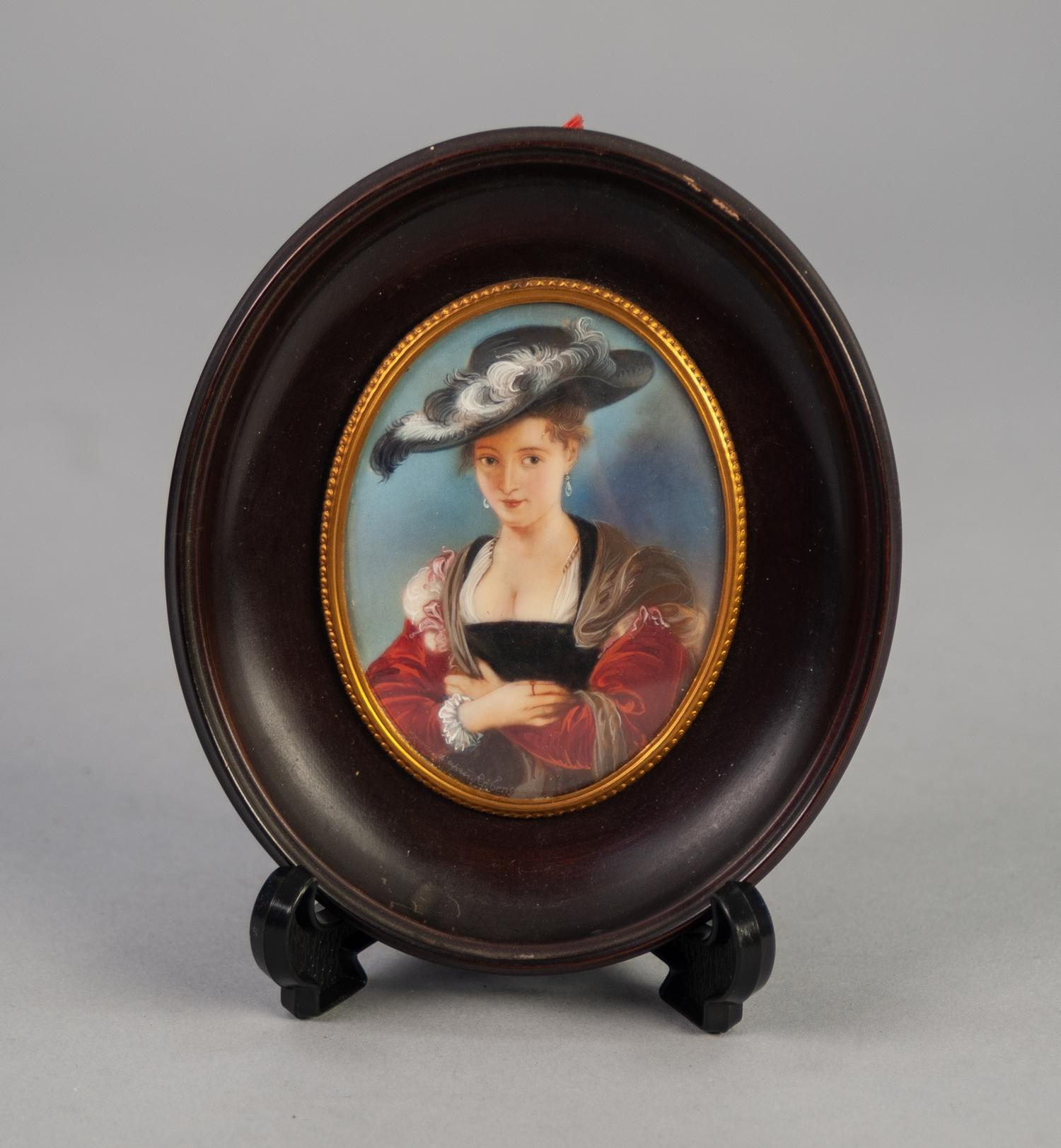 "Lot 882 - AFTER RUBENS PORTRAIT MINIATURE 'Le Chapeau de Paille' oval 3 1/2"" x 2 1/2"" in ebonised frame"