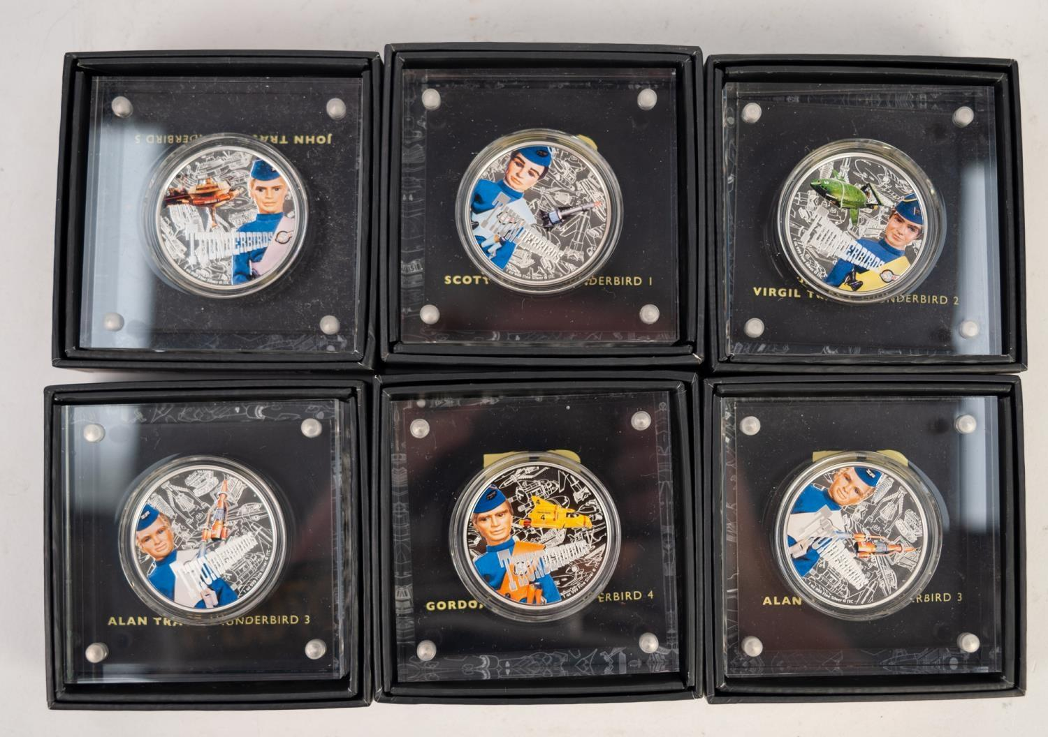 Lot 527 - SIX MINT AND BOXED THUNDERBIRDS 60 YEARS COMMEMORATIVE SILVER AND ENAMEL MEDALLIONS each with