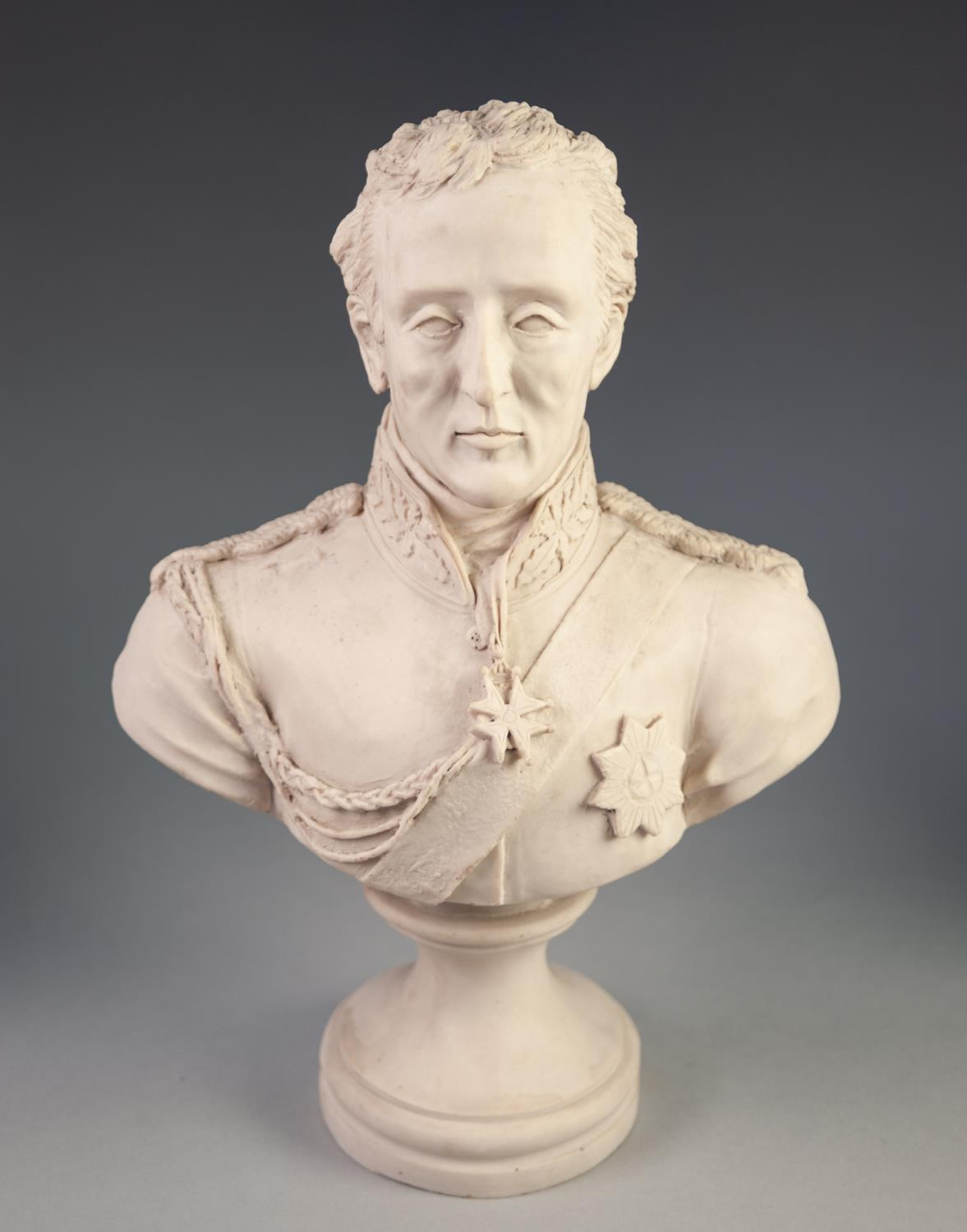 Lot 243 - RECONSTITUTED MARBLE BUST OF THE DUKE OF WELLINGTON in military/ceremonial attire raise on a waisted