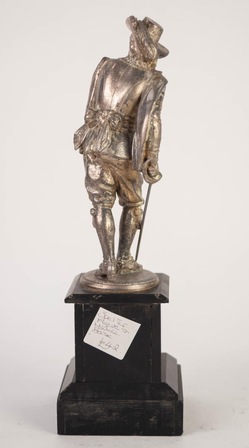 Lot 239 - LATE 19th CENTURY PLATED SPELTER FIGURE OF A BEARDED CAVALIER WITH PLUMED HAT AND SWORD on a black