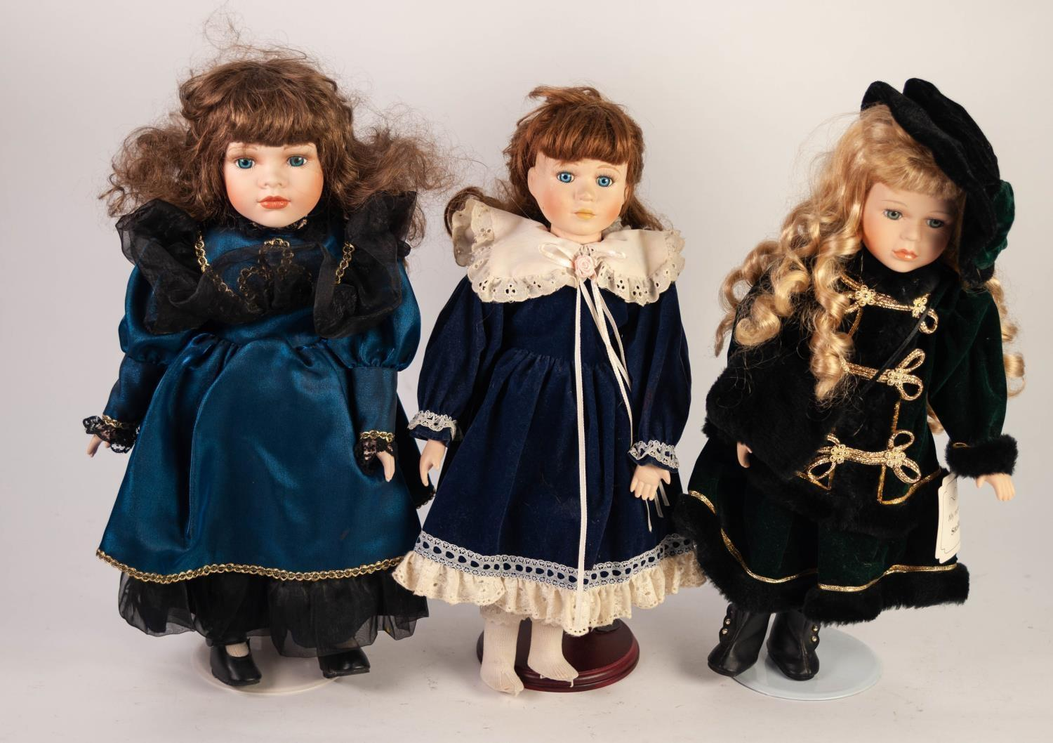 Lot 518 - GROUP OF TEN MODERN DOLLS, all having porcelain head and limbs, all on stands, all female on various