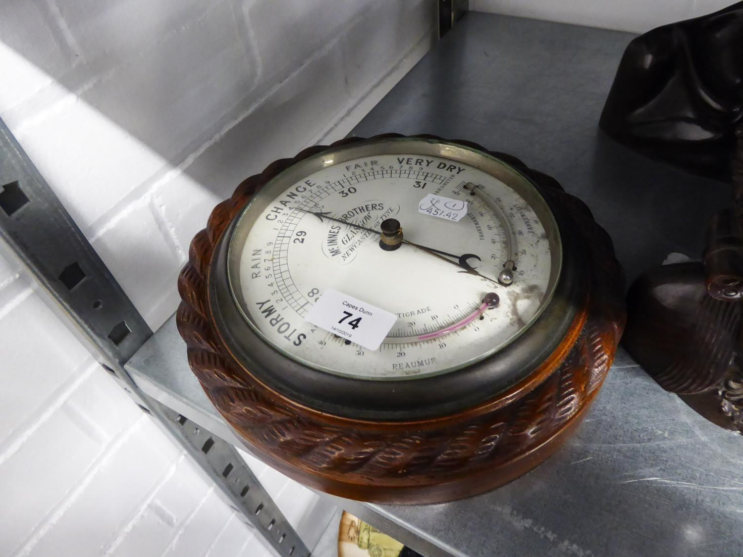 Lot 74 - A LATE VICTORIAN MCINNES BROTHERS, Glasgow, CARVED OAK FRAMED ANEROID BAROMETER