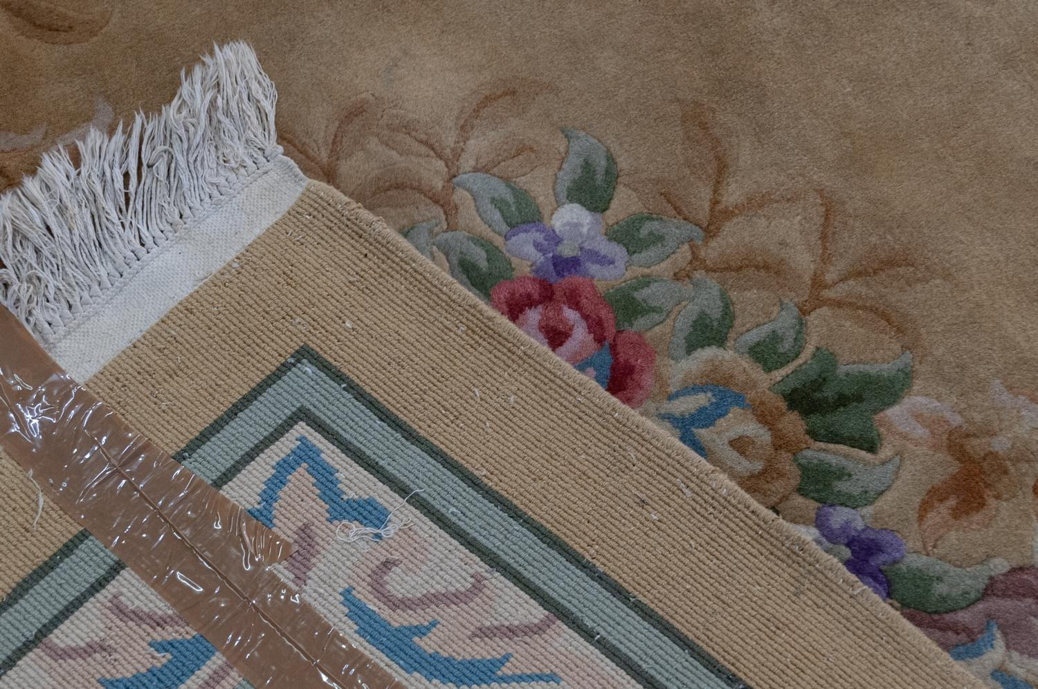 Lot 60 - EMBOSSED CHINESE CARPET of Aubusson design with floral centre medallion and spandrels on an off-