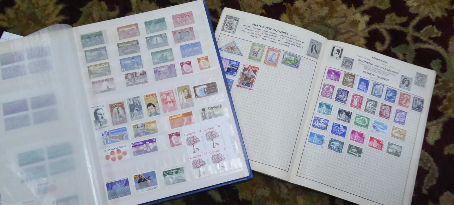 Lot 415 - STAMPS, BLUE STOCKBOOK, mainly QE II, including Canada, and small selection of USA, GAY VENTURE