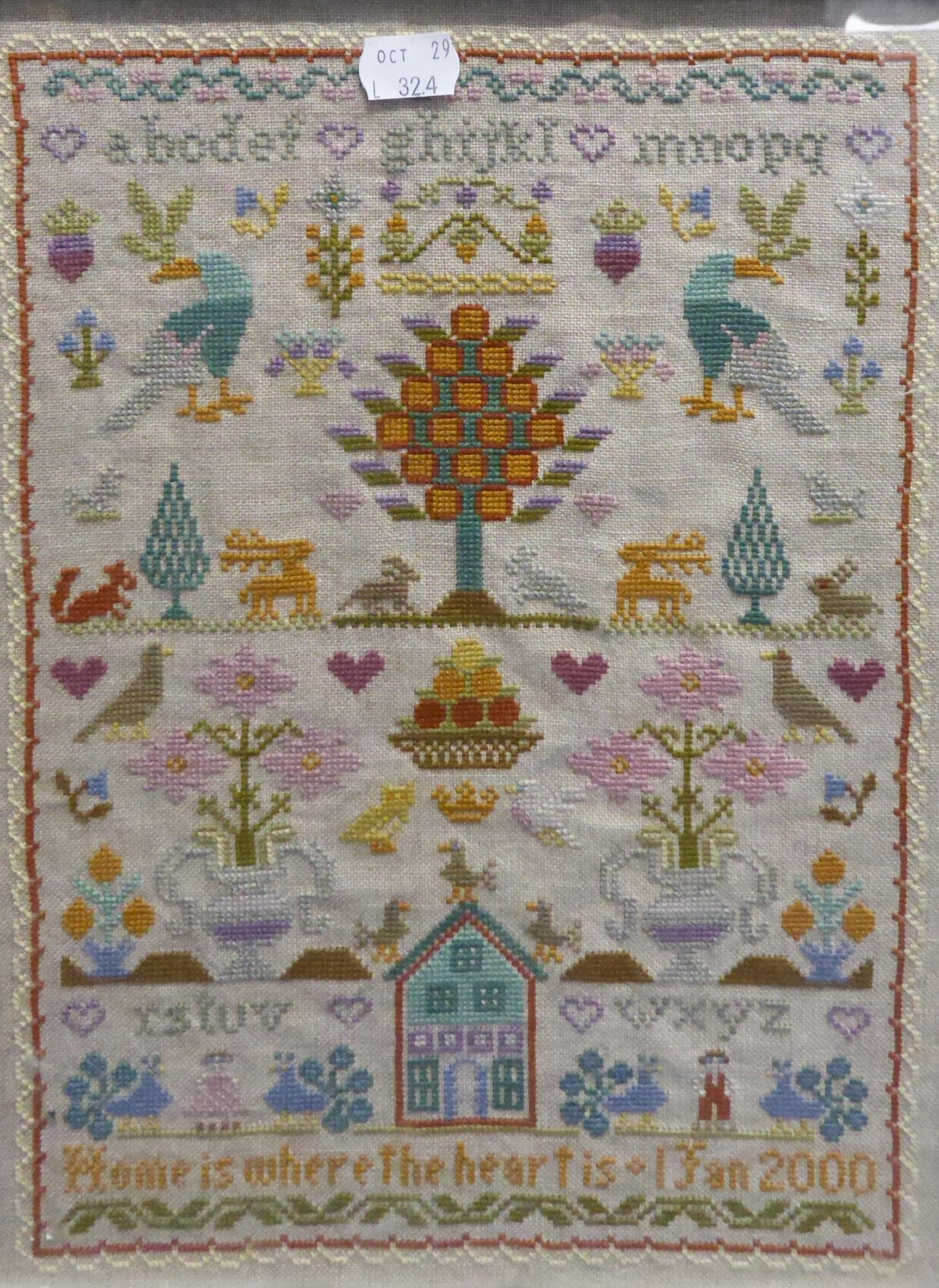 Lot 324 - MODERN NEEDLEWORK SAMPLER, worked in coloured threads with animals and flowers, the alphabet and '