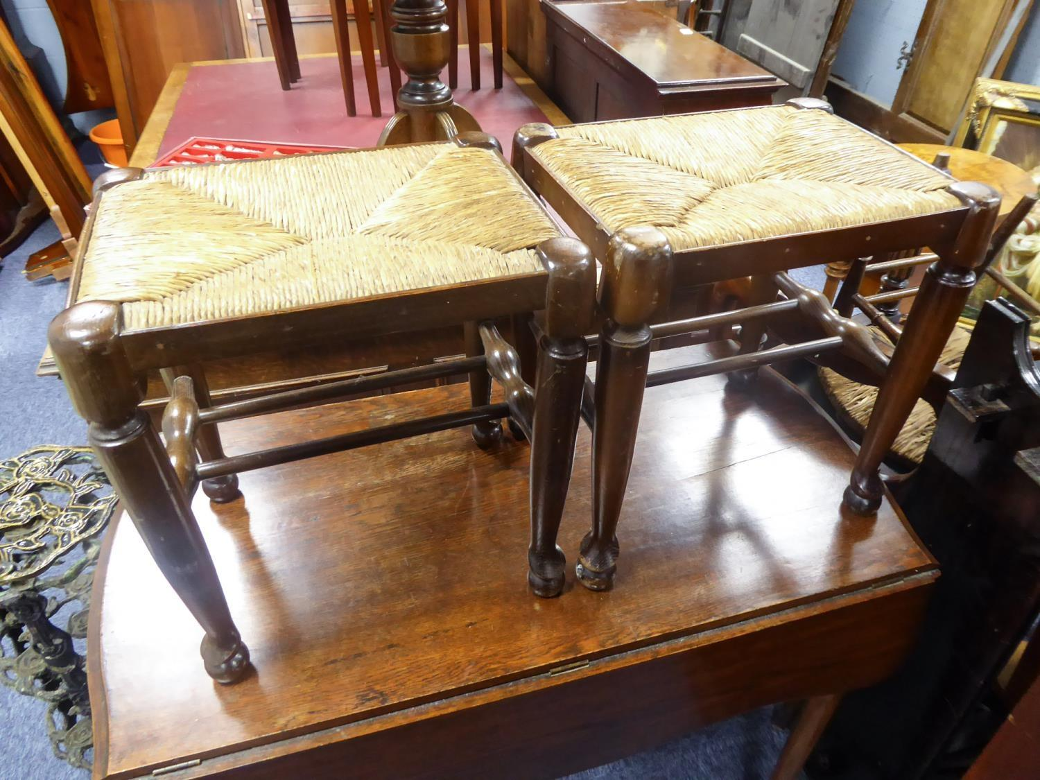 Lot 217 - PAIR OF GEORGIAN COUNTRY STYLE RUSH SEATED OAK STOOLS, each of oblong form with turned, tapering
