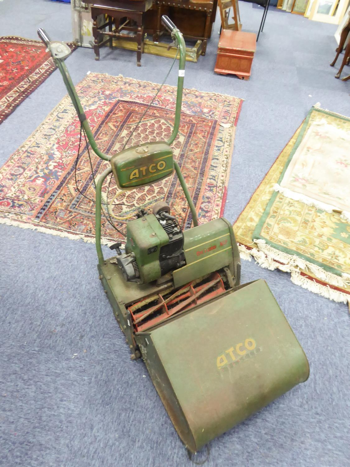Lot 207 - ATCO DELUXE B17 PETROL DRIVEN LAWN MOWER, with grass box and instruction manual