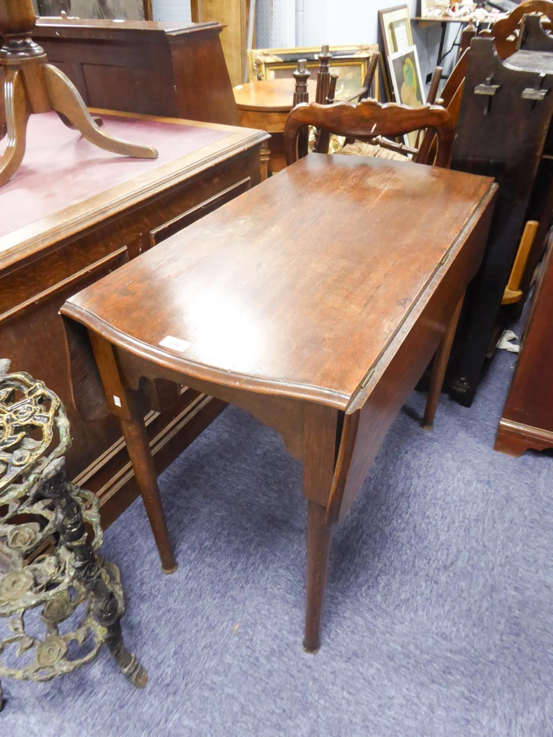 Lot 210 - GEORGIAN STYLE OAK 'BUTTERFLY' PEMBROKE TABLE, the moulded, swivel top above a shaped frieze, and