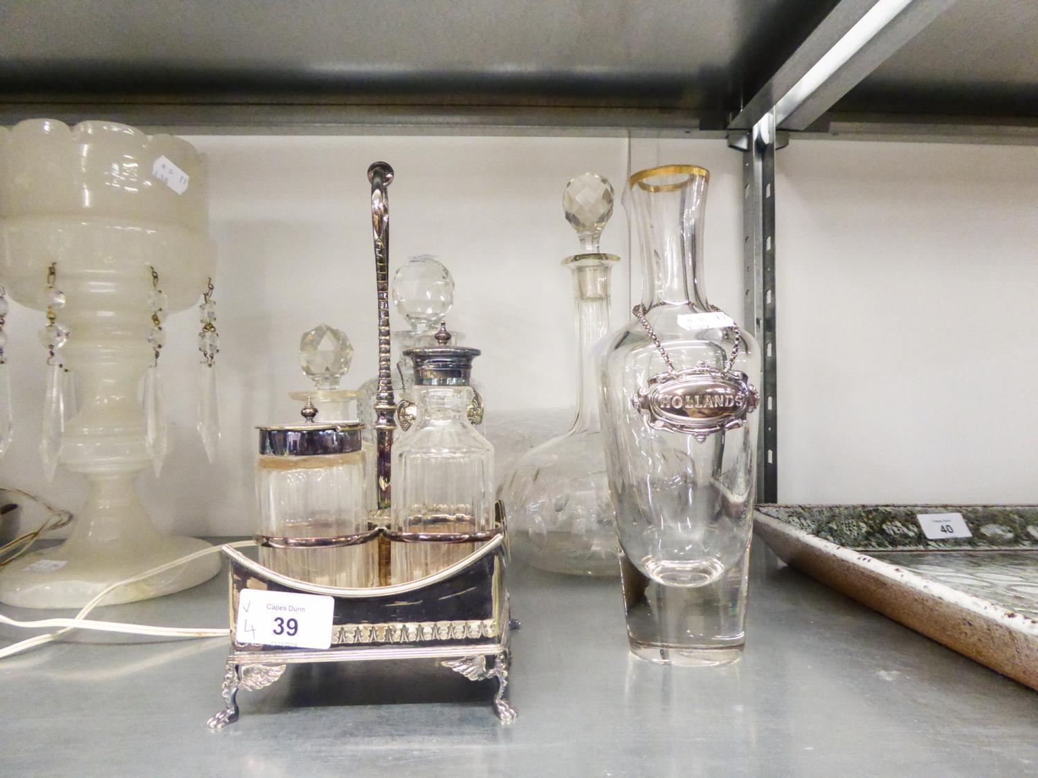 Lot 39 - THREE VARIOUS DECANTERS, ONE WITH 'BRANDY' LABEL, ANOTHER WITH 'HOLLANDS' LABEL AND A FOUR PIECE