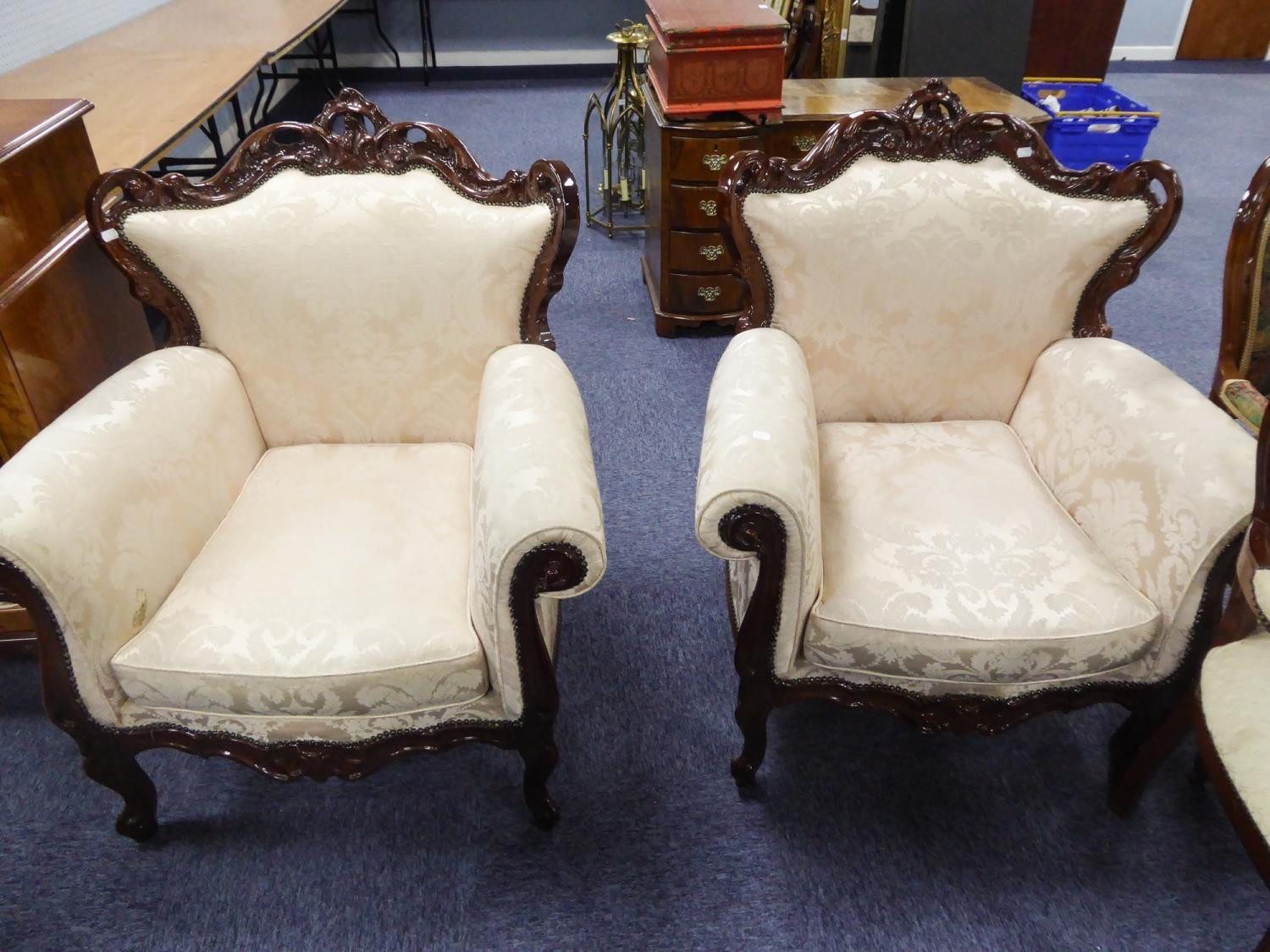 Lot 95 - A NINETEENTH CENTURY STYLE THREE PIECE LOUNGE SUITE WITH ORNATE FRAMEWORK, COVERED IN CREAM FLORAL