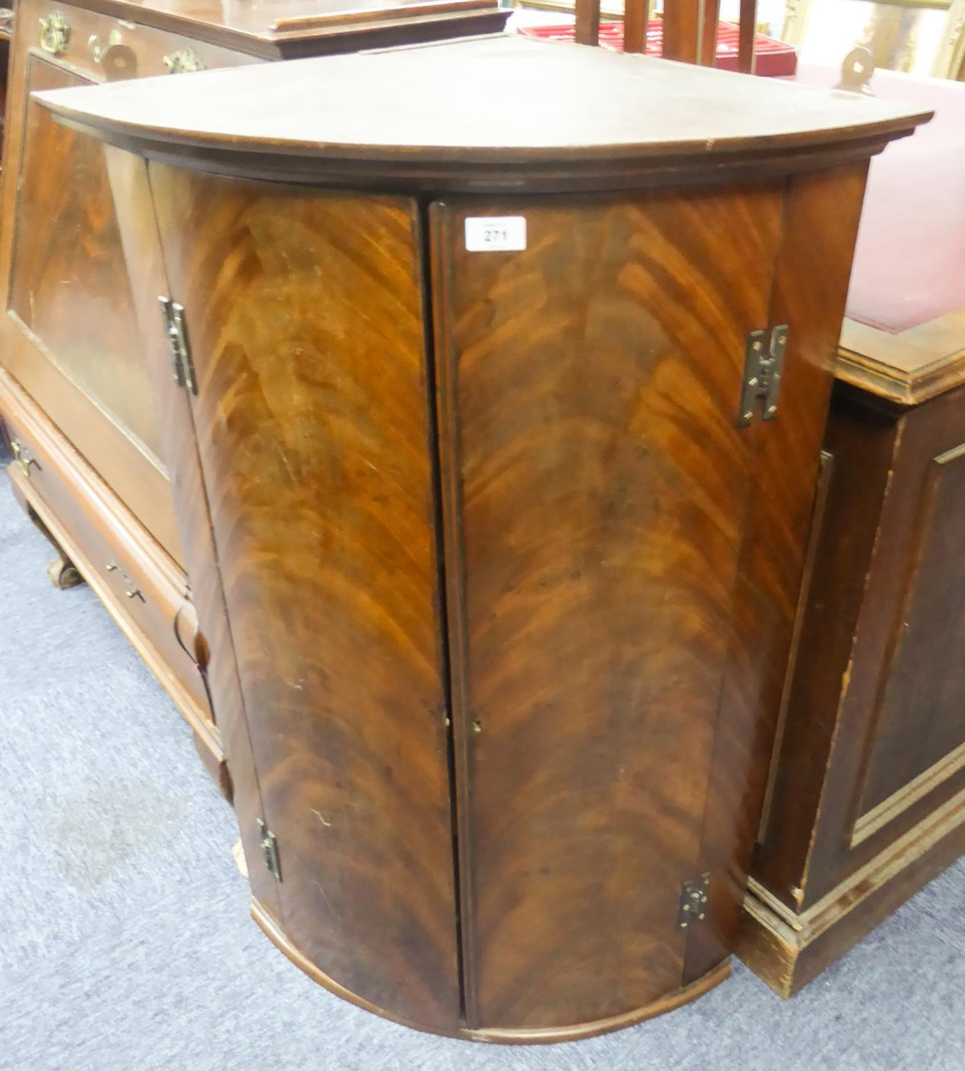 Lot 50 - GEORGIAN FLAME CUT MAHOGANY BOW FRONTED CORNER CUPBOARD, of typical form with exposed brass H hinges