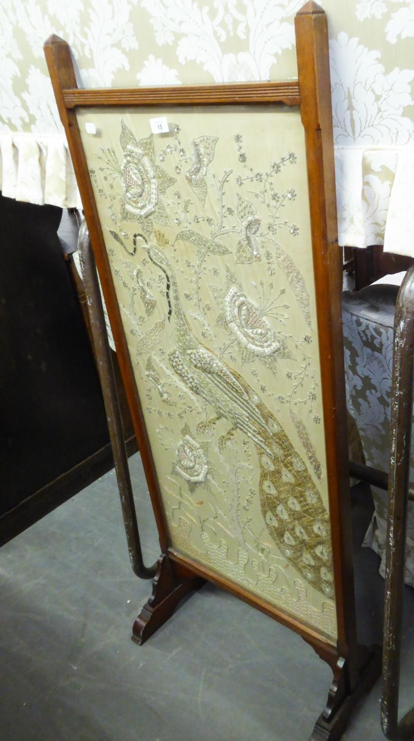 Lot 15 - A LARGE RECTANGULAR FIRESCREEN, DECORATED WITH SILK EMBOSSED PEACOCK AND FLOWERS