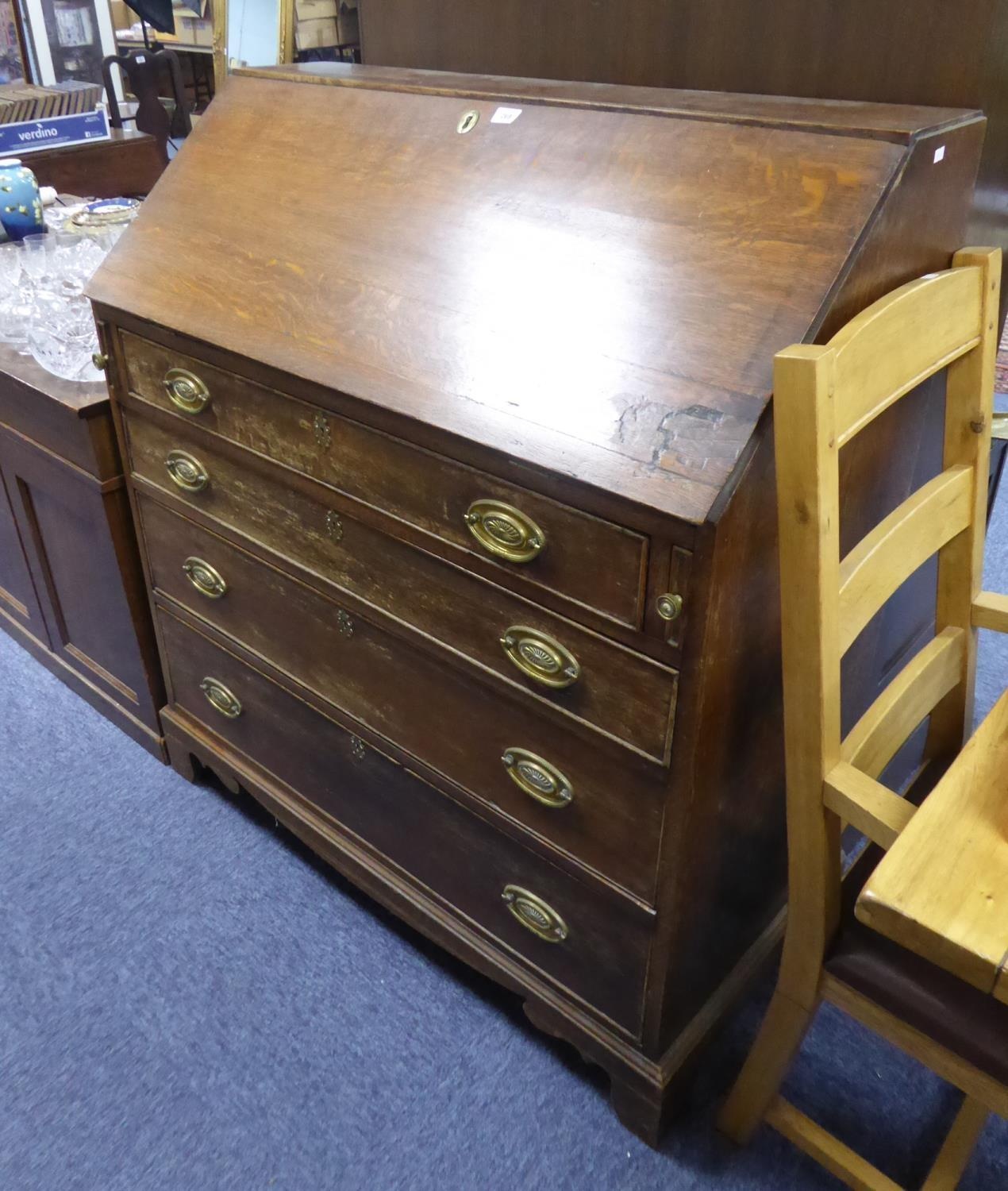 Lot 49 - GEORGE III OAK LARGE BUREAU, of typical form, the pine interior fitted with pigeon holes, set