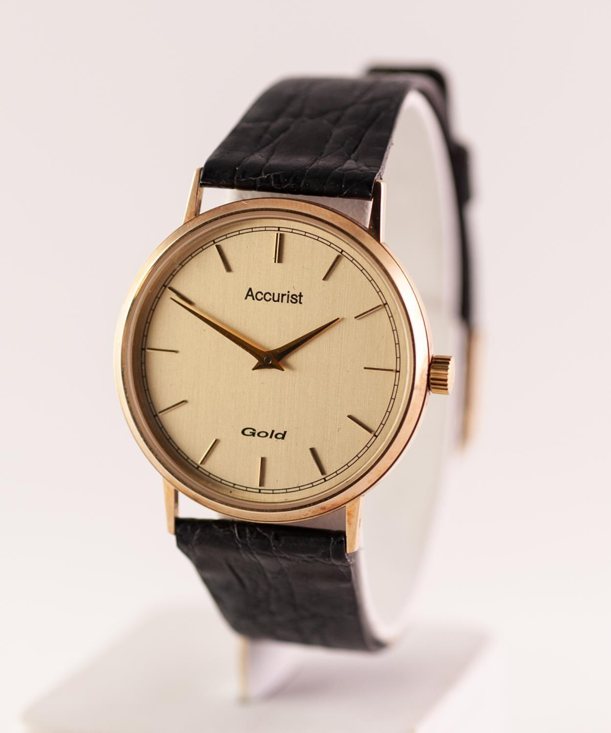 Lot 47 - A 9CT GOLD CASED ACCURIST QUARTZ WRISTWATCH The circular shape gold tone dial with baton hour