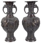 A pair of large decorative twin handled Japanese bronze vases