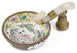A 19th century Chinese Canton enamel libation cup with carved jade handle