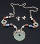 An early 20th century Chinese jade, silver and enamel pendant necklace