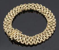 A 9ct gold articulated bracelet of bar link design