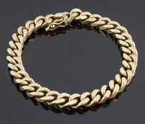A contemporary yellow metal curb link bracelet