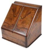 A Victorian walnut desk stationary box