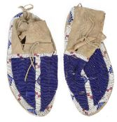 A pair of Native American full size beaded moccasins