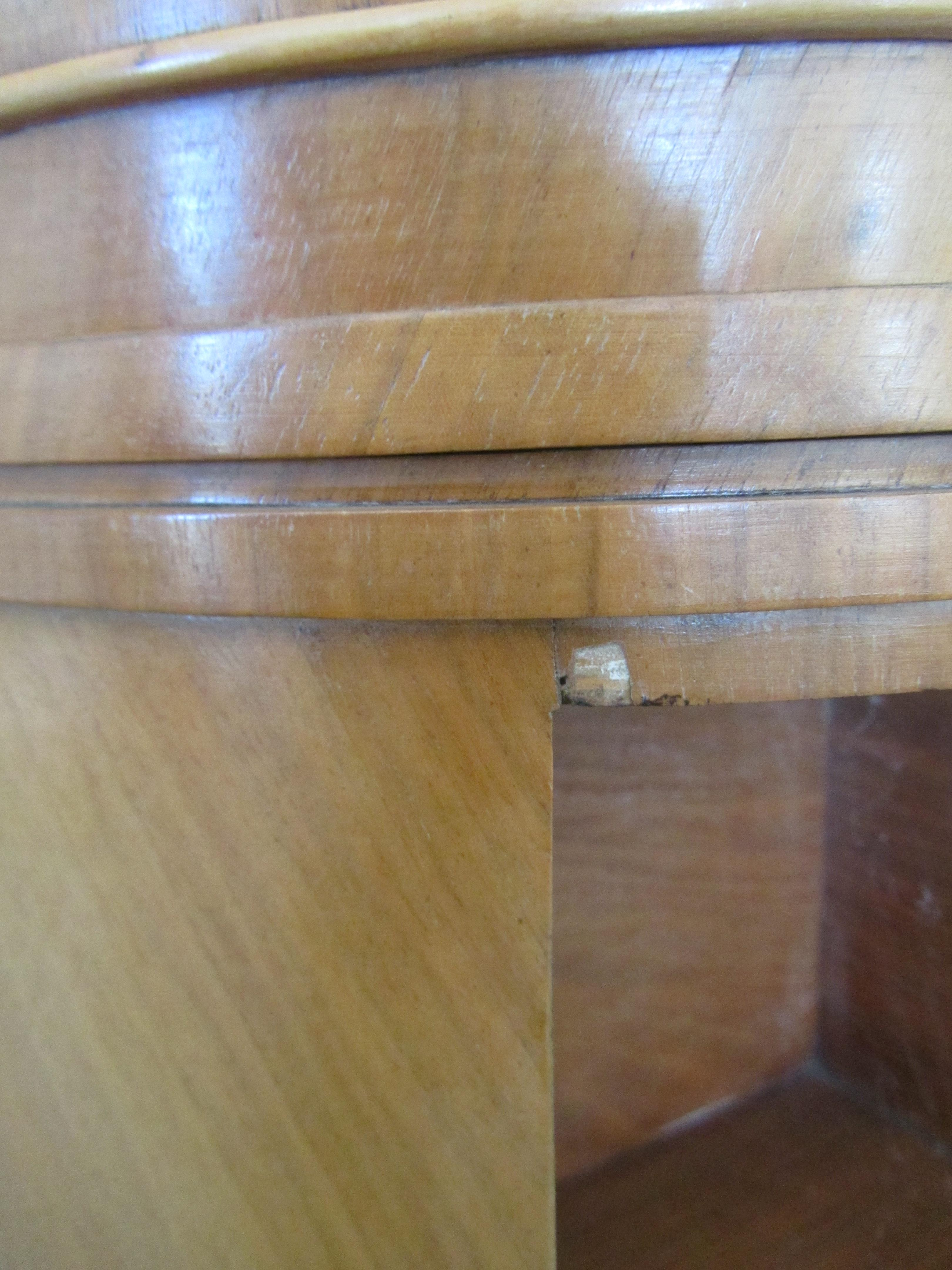 Lot 6 - An Art Deco walnut cloud occasional table c1930s