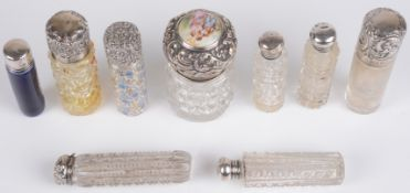 A collection of Victorian glass and silver topped cylindrical bottles