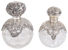 Two globular cut glass and silver scent bottles