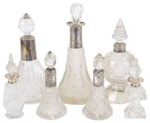 A small collection of Victorian and later glass and silver collared perfume bottles