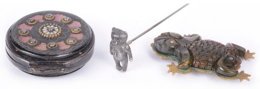 An unusual Bakelite frog brooch and others