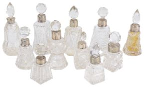 A collection of glass and silver perfume bottles