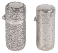 A Victorian embossed silver perfume bottle and another silver perfume bottle