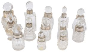 A collection of small glass and silver scent bottles