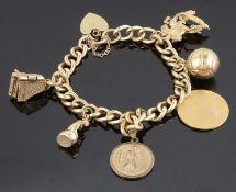 A yellow metal curb link charm bracelet