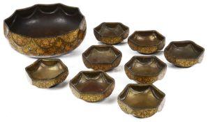 A suite of Kashmir papier mache and metal lined bowls