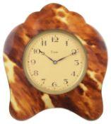 A faux tortoiseshell travelling clock