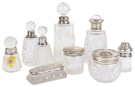 An assorted collection of silver and glass perfume bottles