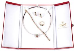 An attractive suite of contemporary Continental diamond, emerald, sapphire and ruby set jewellery