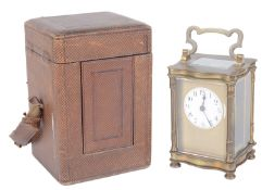 A late 19th century brass carriage clock