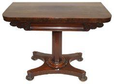 A Victorian mahogany fold over card table