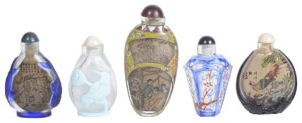 Five 20th century Chinese glass snuff bottles