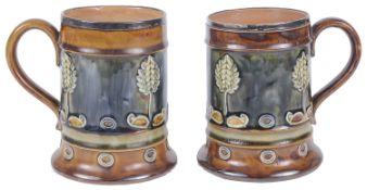 A pair of Royal Doulton stoneware silver rimmed tankards