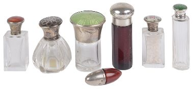 A collection of silver and enamel topped bottles and others