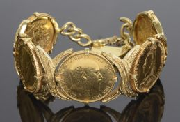 An 18ct gold bracelet formed of five articulated sovereign panels