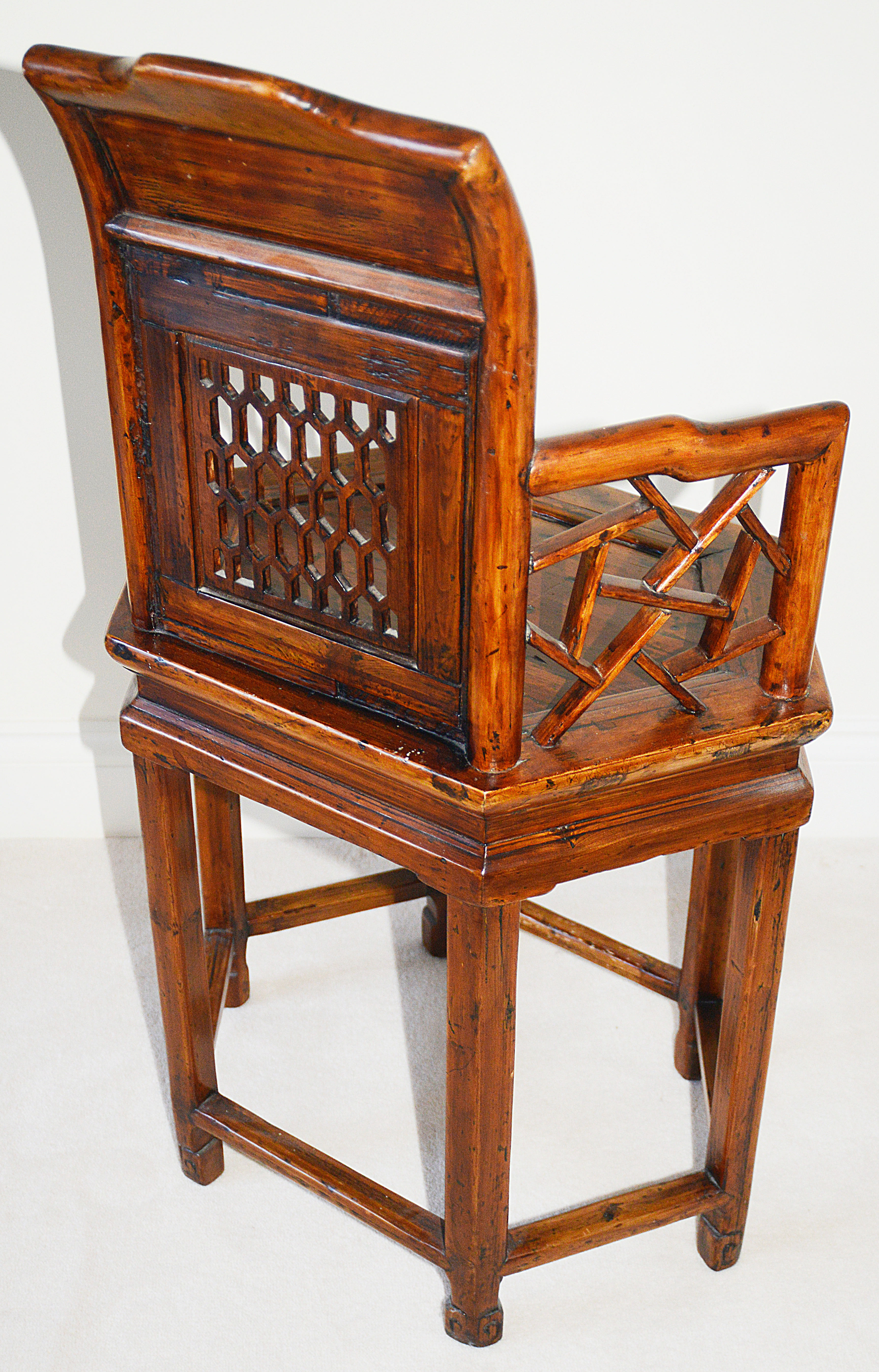 Lot 3 - A Chinese carved hardwood chair