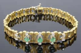 An attractive Continental emerald and diamond set articulated bracelet